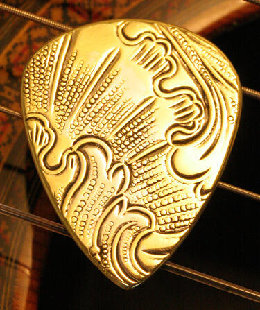 antique brass guitar pick